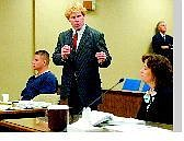Shannon Litz/Nevada Appeal News Service Defense attorney Kevin Walsh, standing, makes a point during a hearing on whether Court TV should be allowed in the Michael Ward trial. Ward sits at left, as prosecutor Dina Salvucci listens on Thursday in Judge Michael Gibbons court.