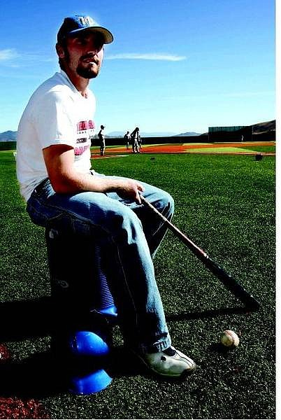 Chad Lundquist/Nevada Appeal Catcher, Aaron Greer, sits on the baseball field at WNCC on Wednesday.