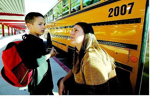 BRAD HORN/Nevada Appeal Melissa Bailey takes her son Donivan, 6, to talk to the bus drivers at Fritsch Elementary School to figure out how he got lost trying to get home Tuesday.