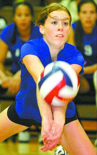 BRAD HORN/Nevada Appeal Carson High's Morgan Nuckolls passes the ball against Douglas on Thursday night in Minden.