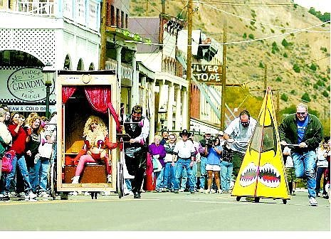 Brad Horn/Nevada Appeal The Ole Tyme Classic, left, and the Urinator race down C Street in Virginia City during the first heat of the 10th annual World Championship Outhouse Races on Saturday. Riding the Classic is Pammers Biddle of the Ole Tyme Saloon.