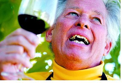 Brian Sokol/Nevada Appeal Gene Donner swirls a glass of fine cabernet sauvignon at his home in Carson City.