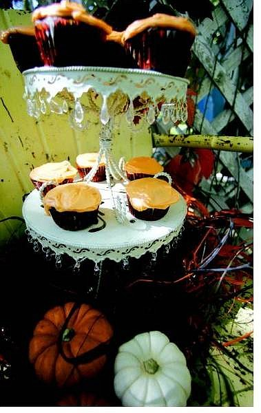 BRAD HORN/Nevada Appeal Linda Marrone's chocolate pumpkin cupcakes with cram cheese frosting will please a Halloween party crowd.