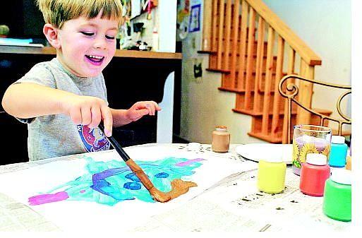 "Three-year-old Noah Lyle has been selling his paintings on eBay.    BELOW: Noah's work ""Purple Goldfish""     Julie Sullivan/ Nevada appeal News Service"