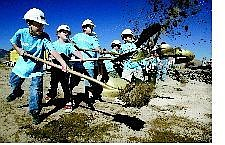 Cathleen Allison/Nevada Appeal Local dignitaries and kids turned out for a groundbreaking ceremony Friday morning for the new Boys & Girls Club of Western Nevada off of Northridge Drive. From left, Casley Matthews, 10, Cory Wilson, Jesse Knight and Oscar Chavez, all 9, participate in the ceremony.