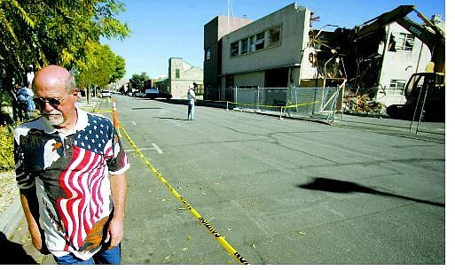 Brad Horn/Nevada Appeal Bob McCulloch, a retired firefighter with the Warren Engine Co., walks away after watching the building he worked in for 28 years being torn down Friday.