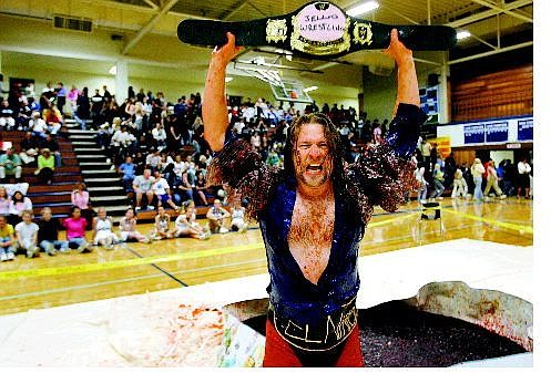 Cathleen Allison/Nevada Appeal Carson High School physics teacher Mark Johnson celebrates after defeating English Teacher Joe Thornberg in a Jell-O wrestling match in the homecoming assembly at the school Friday afternoon.