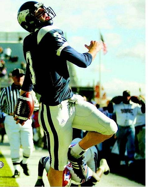 Nevada Wolf Pack quarterback Jeff Rowe reacts after scoring a touchdown against the Louisiana Tech Bulldogs at Mackay Stadium in Reno, Nev., on Saturday, Oct. 15, 2005. The junior quarterback ran for two touchdowns in Nevada's 37-27 victory. AP Photo Brad Horn/Nevada Appeal