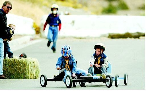 BRAD HORN/Nevada Appeal Nathaniel Darden, 7, right, and Fritz Filson, 7, crash near the finish line during their heat in the soapbox derby on Saturday. The derby is one of the many events Cub Scout pack 143 does annually to teach the boys responsibility and sharing.