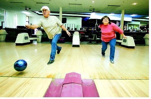 BRAD HORN/Nevada Appeal Gary and Sharon Wood bowl a warm-up game at the Carson Lanes on Wednesday. Gary and his wife will be running the 21st annual American Indian Bowling Tournament during the Nevada Day weekend.