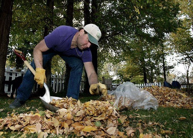 Chad Lundquist/Nevada Appeal Robert Egelston, bags up piles of leaves in attempt to keep up with the fall season, at his home on the west side of Carson City on Tuesday.