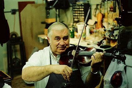 Submitted photo Dennis Butterfield, a string repairman, restored the historic violin in his Reno Maytan Music Center shop. He will play it with his orchestra during the 1864 Governor's Ball tonight at Piper's Opera House in Virginia City.