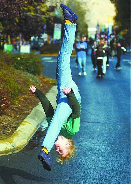 BRAD HORN/Nevada Appeal Tamara Holmes does a flip during the Nevada Day Parade on Saturday. Holmes works with Positive Energy gymnastics in Carson City.