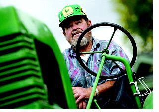 Chad Lundquist/Nevada Appeal Gary Graeber, 64, sits atop his 1939 John Deere Model L tractor, at his home in Carson City. Graeber will be at the Nevada Railroad Museum all day today with his son, Jason, and other members of the Northern Nevada Antique Power Club.