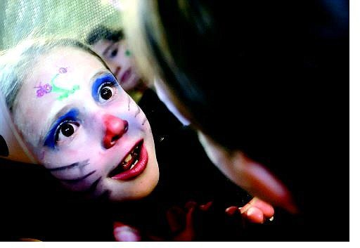 Chad Lundquist/Nevada Appeal Tiana Rae Snow, 6, of Mound House, sees her reflection after getting her face painted Sunday night at the Trick-or-Treat Time event at the Northern Nevada Children's Museum.