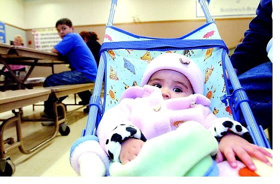 Rick Gunn/Nevada Appeal Roxanna Cano, 7 months, sits with her sister Alejandra (not shown) during last year's Hispanic Community Information Night at Bordewich-Bray Elementary School.