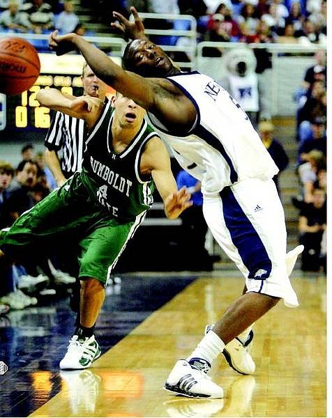 BRAD HORN/Nevada Appeal Marcelus Kemp gets fouled by a Humboldt State player during their exhibition game at Lawlor Events Center Saturday.