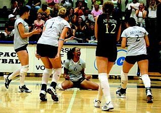 BRAD HORN/LVN News Service Salaia Salave'a, center, leads the celebration after the Nevada Wolf Pack volleyball team beat the 13th-ranked UCLA Bruins in game four to tie the match taking it into game five at the Virginia Street Gym Sept. 3.  With Salave'a, from left, are Tristin Johnson, Teal Ericson (1), Christine Harms (12) and Allison Hernandez (2).