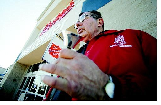 BRAD HORN/Nevada Appeal Glenn Phillips rings the Salvation Army Bell for his second year in front of the Wal-Mart Supercenter at Topsy Lane on Tuesday.