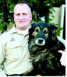 Douglas County Sheriff's Sgt. Joe Duffy with his dog, Kilo, who is credited with tracking down a suspect in a Minden bank robbery.  Shannon Litz/Nevada Appeal News Service