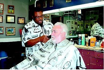 Mary Jean Kelso/Nevada Appeal News Service Fernley's new and now only barber, Charles Porter, gives Don Thomas of Fernley a trim. Charlie's Country Barbershop opened Sept. 2 at 25 W. Main St. Fernley residents fill the shop daily, waiting in line for the door to open at 9 a.m., keeping Porter busy until quittin' time at 6 p.m.