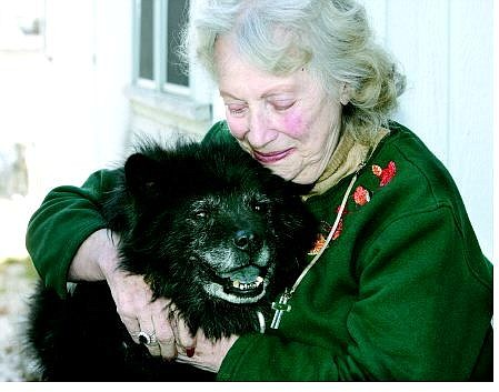 Cathleen Allison/Nevada Appeal Doris Rice hugs her 11-year-old dog, Taz, Wednesday after being reunited with him.