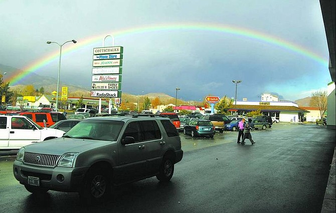 BRAD HORN/Nevada Appeal A rainbow is cast over the Carson Mall on Friday morning while shoppers hunt for sales.