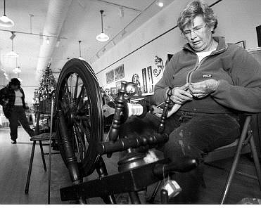 Chad Lundquist/Nevada Appeal Marilynn Clarke of Reno, spins wool into yarn on a spinning wheel at Brewery Arts Center during The Artisans' Store annual holiday open house on Sunday.