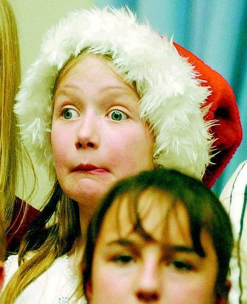 BRAD HORN/Nevada Appeal Miranda Callahan, 10, of Bordewich Bray Elementary School, sings with the Carson City Fifth-Grade Students Singing Musical Ensemble during the Silver & Snowflakes 2005 Traditional Christmas Tree Lighting at the Nevada State Capitol on Thursday.