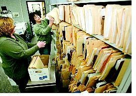 Cathleen Allison/Nevada Appeal Carson City Sheriff's Records Clerks Milani McKinley, left, and Rebecca Neep pack up old records Friday for the move across town. They estimate they'll fill between 800-1,000 boxes with old records dating back to the late 1960s.