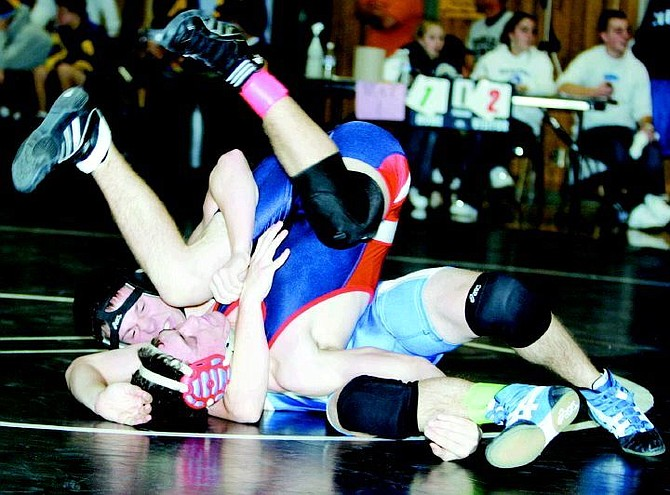 BRAD HORN/Nevada Appeal Carson's Brian Halverson wrestles his opponent on Saturday.