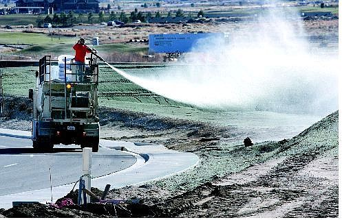 Cathleen Allison/Nevada Appeal Rusty Stokes of Sierra Erosion Control, Inc. sprays hydroseed on the retention basins around the Carson Tahoe Regional Medical Center on Tuesday afternoon. They expect to finish the nine-acre job Thursday.