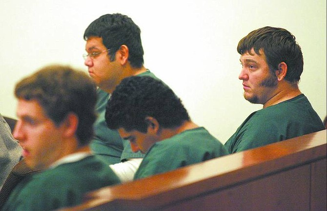 BRAD HORN/Nevada Appeal Danny Shaw-White, from left, Tyler Cruz, Juan Cervantes, and Fred Bechtold watch video tape during their preliminary murder trail at the Carson City Courthouse on Friday.