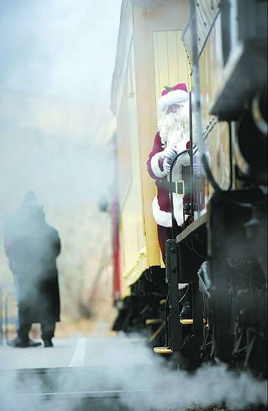 Chad Lundquist/Nevada Appeal Santa Claus prepares to dismount the train Sunday during the 18th annual Santa Train at the Nevada State Railroad Museum.