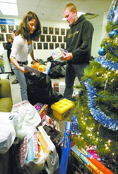 Cathleen Allison/Nevada Appeal  Carson High School National Honor Society members Lianne Aglietti, 17, and Loren Wooldridge, 18, pack up the hundreds of toys collected by the N.H.S. for the Toys for Tots program.