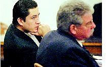 BRAD HORN/Nevada Appeal Maximiliano Cisneros listens to the prosecution present closing arguments at the Carson City courthouse on Friday. Cisneros is charged with second-degree murder and attempted murder.