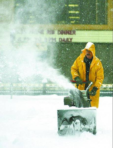 Brad Horn/Nevada Appeal Ron Kaher, an employee of Cactus Jack's Casino in Carson City. plows a side street in front of the casino during a snowstorm on Sunday. A fast-moving front brought more than 8 inches of snow in less than 12 hours.