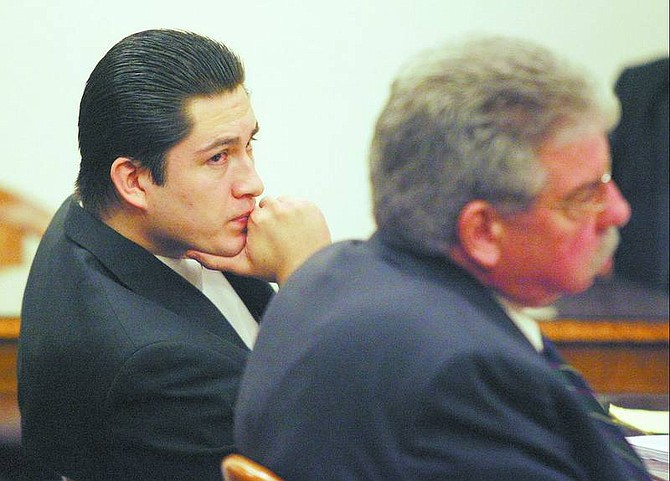Maximiliano Cisneros listens to the prosecution present closing arguments at the Carson City courthouse on Friday. Cisneros was found guilty today of  second-degree murder.