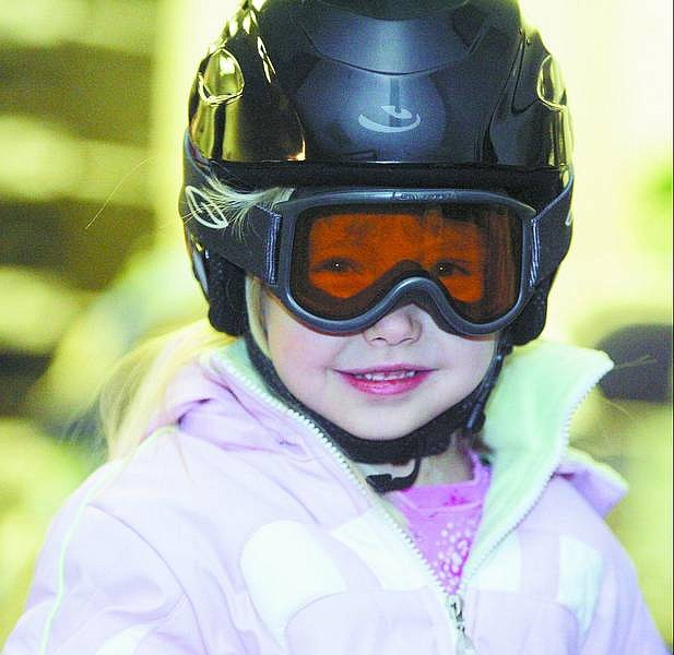 photos by BRAD HORN/Nevada Appeal Tessa Stevens models a helmet and goggles at a ski- and bike-helmet fitting and sale at the old Carson-Tahoe Hospital on Saturday.
