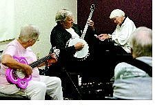 Cathleen Allison/Nevada Appeal A group of music enthusiasts get together to make music at the Carson City Senior Citizen Center on Tuesday. From left, Alice Gregor on bass, Richard Taylor on banjo, Reba Tawlks on keyboard and Bob Chambers on guitar.