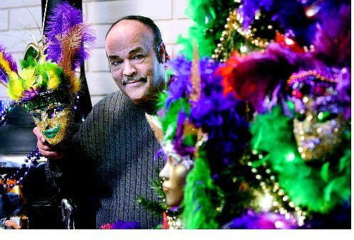Cathleen Allison/Nevada Appeal Charles Adams shows off his Mardi Gras Christmas tree, decorated to remind people of the spirit of New Orleans.