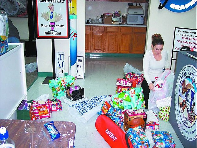 Candice Mondragon gathered Christmas gifts for teenagers as part of her senior project at Carson High School.