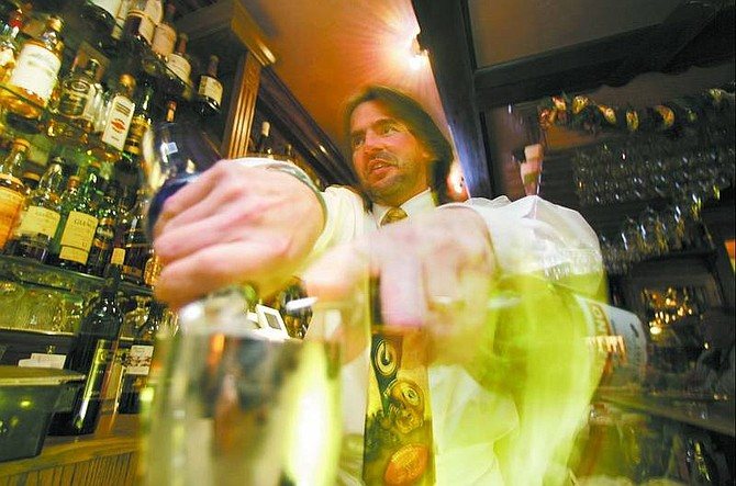 BRAD HORN/Nevada Appeal Mark Nadreau mixes a vodka martini at the Adele's Restaurant Bar in Carson City on Wednesday.