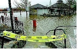 Shannon Litz/Nevada Appeal News Service Walley's Hot Springs Resort flooded near the gazebo Saturday. In the Carson Valley, Genoa and the Foothill area were hit hardest by the storm.