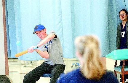 Rick Gunn/Nevada Appeal Jack Maloney drives one home during a game of Nerf baseball in the Carson Rehabilitation  Center in March. During the spring 2005 baseball season, Maloney was diagnosed with the potentially deadly disease called Guillain-Barré Syndrome that left him paralyzed.