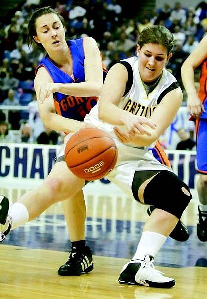 BRAD HORN/Nevada Appeal Galena's Caitlin Anderson fights for the ball against a Bishop Gorman player during their Nevada State Championship semi-final game at Lawlor Events Center on Thursday.
