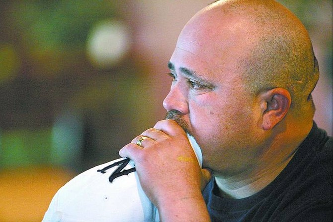 Alberto Garcia watches the final seconds of the Wolf Pack game Thursday afternoon at Stew's Sportatorium. An  overlooked Montana team jumped out to an early lead and never looked back,  leaving Nevada fans shocked at their team's early exit from the big dance.  Cathleen Allison/Nevada Appeal