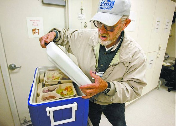Cathleen Allison/Nevada Appeal Fred Dory prepares to deliver Meals on Wheels on Wednesday morning at the Dayton Senior Center. The center is participating in the nationwide movement, March for Meals, to raise money for the program.