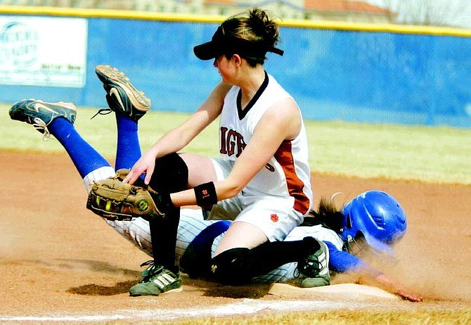 BRAD HORN/Nevada Appeal Carson's Christa Casci gets tagged out on a pickoff play by Douglas first baseman Michelle Nenzel on Friday.