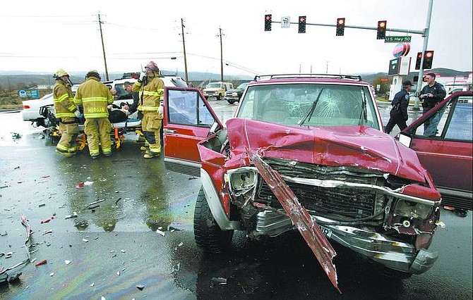 Cathleen Allison/Nevada Appeal Firefighters transported two people to Carson Tahoe Regional Medical Center on Tuesday afternoon after an accident at Graves Lane and Highway 50 East.